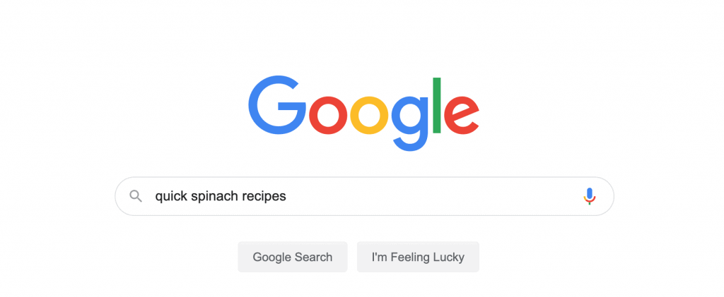 Screenshot of Google search bar with the search query quick spinach recipes in the search field